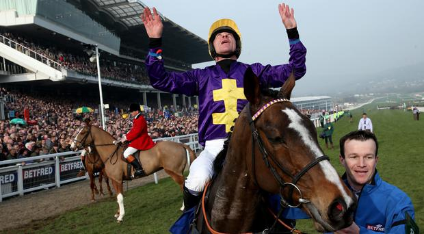 Davy Russell celebrates after riding Lord Windermere to victory in the Betfred Cheltenham Gold Cup Chase on Gold Cup day at the Cheltenham Festival at Cheltenham Racecourse