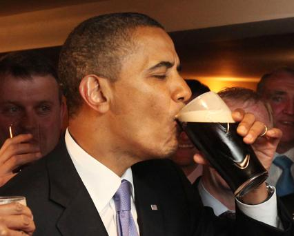 U.S. President Barack Obama drinks from a pint of Guinness stout at the Ollie Hayes pub in Moneygall in May 2011.