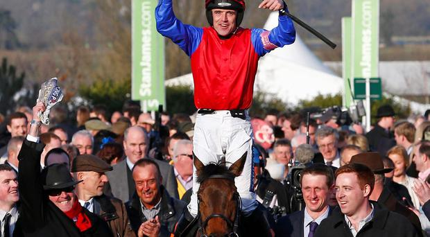 Ruby Walsh on Quevega celebrates after winning the Mares' Hurdle Race during the Cheltenham Festival horse racing meet in Gloucestershire, western England March 11, 2014. REUTERS/Eddie Keogh (BRITAIN - Tags: SPORT HORSE RACING)