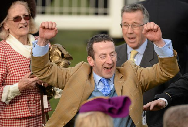 Trainer Jim Culloty celebrates after sending out Lord Windemere to win the BetFred Cheltenham Gold Cup Chase