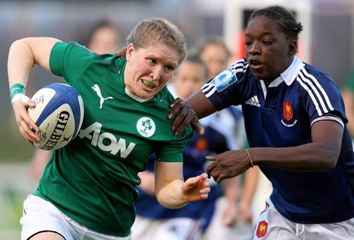 Heather O'Brien, Ireland, is tackled by Diallo Coumba, France