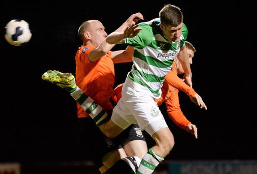 Jason McGuinness of Shamrock Rovers jumps for the ball with Athlone's Alan Byrne at the Athlone Town Stadium