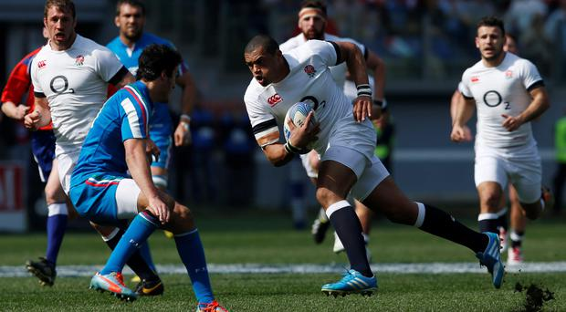 England's Luther Burrell (right) runs at Italy's Leonardo Sarto (left) during the Six Nations match at the Stadio Olympico, Rome, Italy.