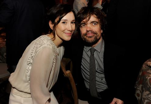 Actors Sibel Kekilli (L) and Peter Dinklage pose at the after party for the premiere of HBO's