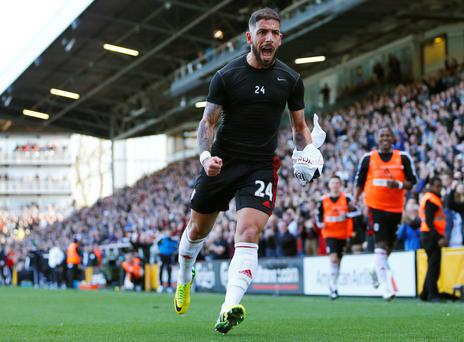 Ashkan Dejagah of Fulham celebrates scoring against Newcastle United during their English Premier League soccer match at Craven Cottage in London