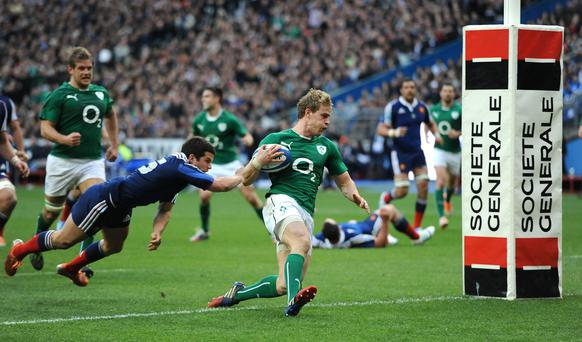 Ireland's Andrew Trimble dives in to score his side's second try during the Six Nations match at the Stade de France, Paris, France.
