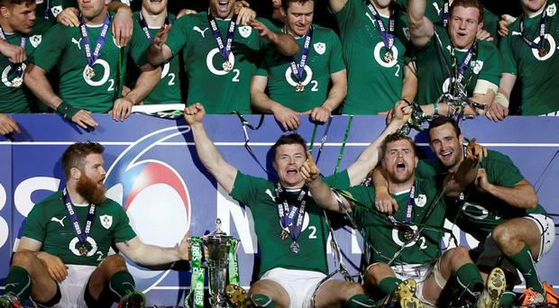 Ireland's players celebrate victory against France at the end of their Six Nations rugby union match at the Stade de France in Saint-Denis, near Paris, March 15, 2014REUTERS/Gonzalo Fuentes (FRANCE - Tags: SPORT RUGBY)