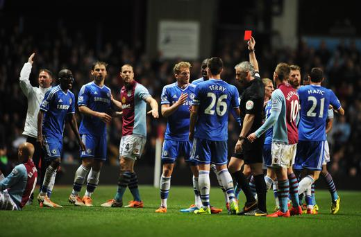 Ramires of Chelsea is shown a red card and is sent off by referee Chris Foy after a challenge on Karim El Ahmadi of Aston Villa.