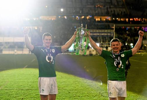 Ireland's Jonathan Sexton, left, and Brian O'Driscoll celebrates with the trophy following their side's victory