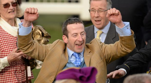 Trainer Jim Culloty celebrates after Lord Windemere crossed the line first in the Gold Cup