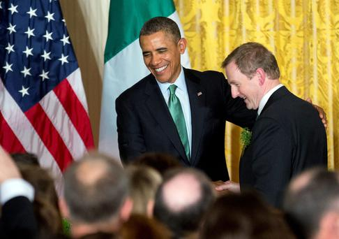 President Barack Obama, left, shakes hands with Enda Kenny, during a St. Patricks Day reception in the East Room of the White House in Washingto. Photo: Manuel Balce Ceneta/AP