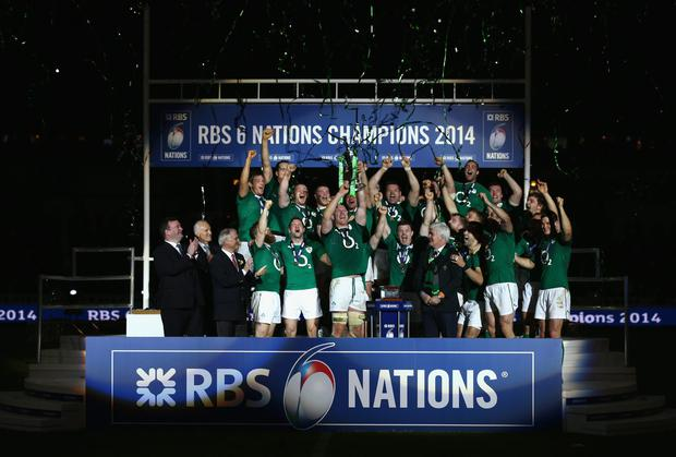 Brian O'Driscoll (C) and captain Paul O'Connell (C) of Ireland celebrate with their team-mates as they lift the trophy after winning the six nations championship with a 22-20 victory over France