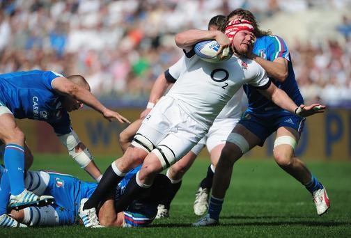 Ben Morgan of England is tackled by Joshua Furno of Italy during the RBS Six Nations match between Italy and England at Stadio Olimpico
