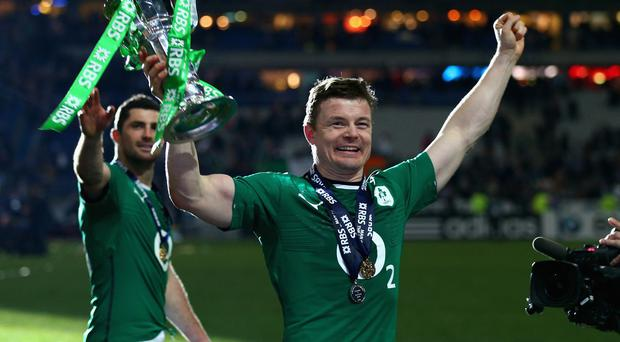 Brian O'Driscoll of Ireland celebrates with the trophy after winning the six nations championship with a 22-20 victory over France