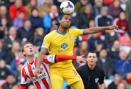 Cameron Jerome of Crystal Palace climbs above Sunderland's Craig Gardner to win the ball during the Barclays Premier League match at the Stadium of Light