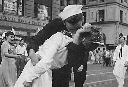 U.S. Navy sailor Glenn Edward McDuffie (L) kisses a nurse in Times Square