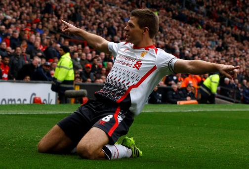 Liverpool's Steven Gerrard celebrates scoring his second penalty against Manchester United.