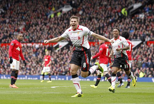 Liverpool's Steven Gerrard celebrates scoring his team's second goal from the penalty spot during the Barclays Premier League match at Old Trafford.