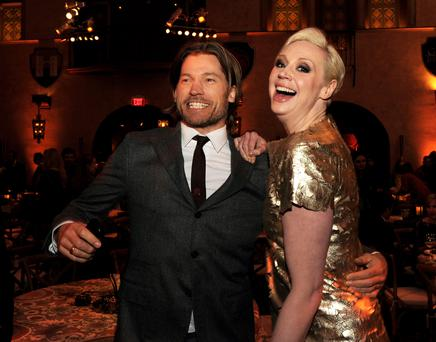 Actors Nikolaj Coster-Waldau (L) and Gwendoline Christie pose at the after party for the premiere of HBO's