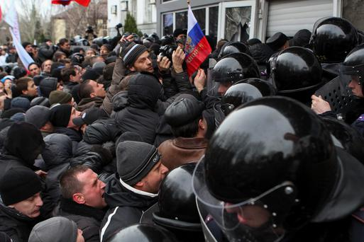 Pro-Russian demonstrators scuffle with police during a rally in Donetsk March 16, 2014. Ukraine accused