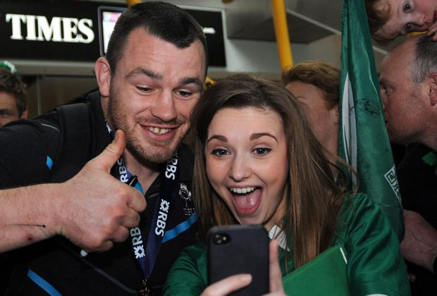 Cian Healy poses for a 'selfie' with a fan.