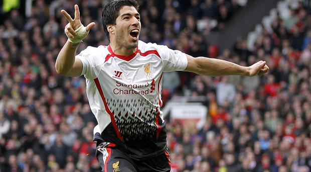 Liverpool's Luis Suarez celebrates after scoring his team's third goal