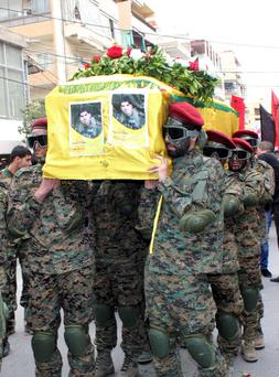 Lebanon's Hezbollah members carry the coffin of their comrade Ahmad Ali Deeb, who was killed in the recent battles in Yabroud, Syria