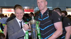 Ireland head coach Joe Schmidt, left, and captain Paul O'Connell with the RBS Six Nations Rugby Championship 2014 trophy on the team's return to Dublin