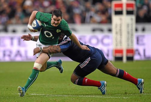 Jonathan Sexton, Ireland, is tackled by Mathieu Bastareaud, France