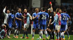 Ramires of Chelsea is shown a red card and is sent off by referee Chris Foy after a challenge on Karim El Ahmadi of Aston Villa