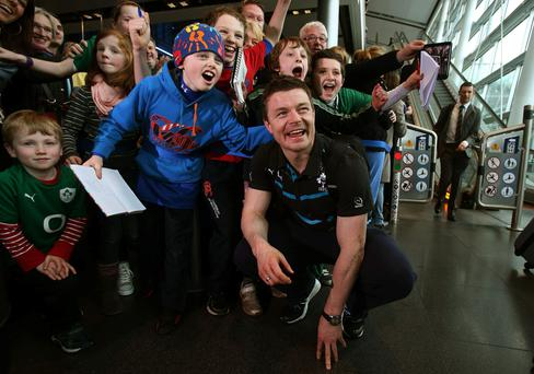 Brian O'Driscoll with supporters as the Ireland team arrive at Dublin Airport
