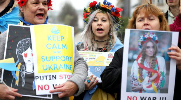 Ukrainians living in Belgium take part in a protest against Russian President Vladimir Putin outside a meeting of European Union foreign ministers in Brussels