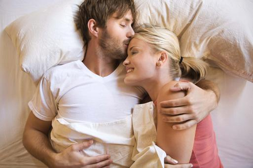 Partners who slept less than an inch apart were more likely to be content with their relationship than those maintaining a gap wider than 30 inches, (Stock photo)