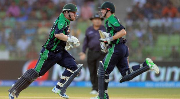 SYLHET, BANGLADESH - MARCH 17: Paul Stirling of Ireland and William Porterfield run between the wickets during the ICC T20 World Cup match between Ireland and Zimbabwe played at Sylhet International Cricket Stadium on March 17, 2014 in Sylhet, Bangladesh. (Photo by Pal Pillai-IDI/IDI via Getty Images)