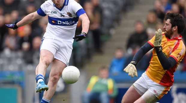Ciarán Dorney of St Vincent's in action against Ciarán Naughton of Castlebar Mitchels.