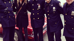 MTV presenter Laura Whitmore with NYPD policemen. Photo: Twitter/@thewhitmore