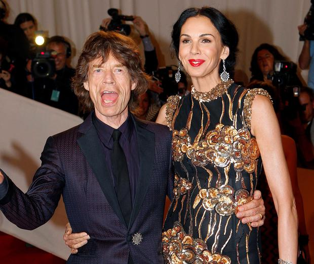 Mick Jagger and designer L'Wren Scott at the Metropolitan Museum of Art Costume Institute Benefit celebrating the opening of Alexander McQueen: Savage Beauty, in 2011. Reuters/Mike Segar/Files