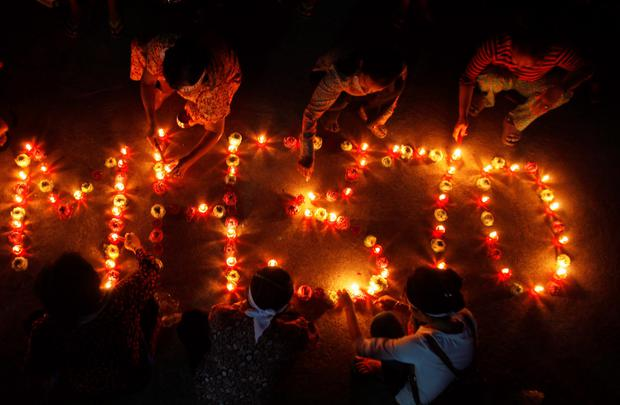 Residents of Boeung Kak Lake light candles to spell