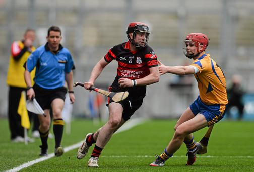 Derek Byrne, Mount Leinster Rangers, in action against Ronan O'Meara, Portumna