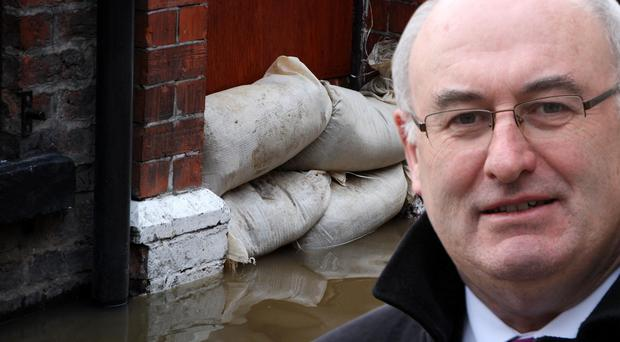 Environment Minister Phil Hogan is considering a flood levy on insurance policies