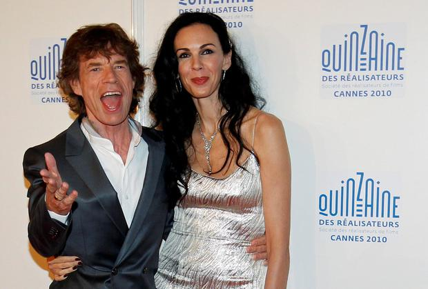 Rolling Stones lead singer Mick Jagger and his girlfriend L'Wren Scott in 2010