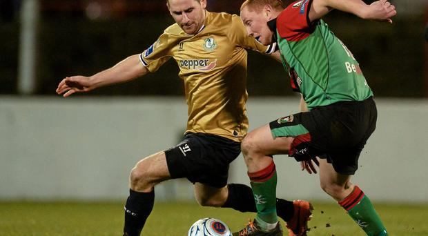 17 March 2014; Dean Kelly, Shamrock Rovers, in action against Stephen McAlorum, Glentoran