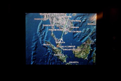 A screen on board Malaysia Airlines Boeing 777-200ER flight MH318 shows the plane's flight path as it cruises over the South China Sea from Kuala Lumpur towards Beijing, at approximately the same point when on March 8 flight MH370 lost contact with air traffic controllers, at approximately 1.30am March 17, 2014. Photo: Reuters/Edgar Su