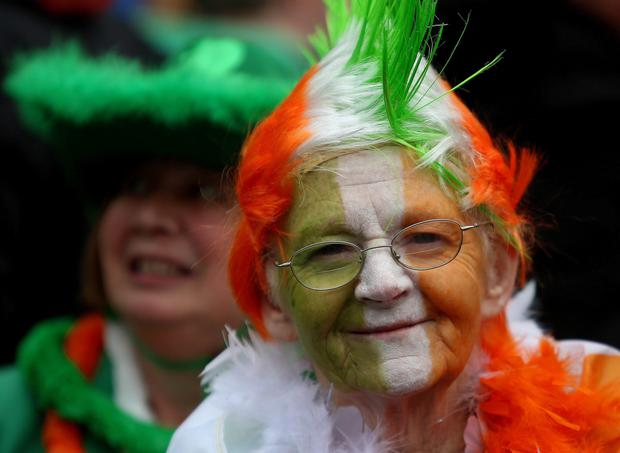 A woman gets into the spirit of the day during the Dublin St Patrick's day parade. Photo: Niall Carson/PA Wire