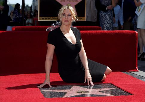 Actress Kate Winslet poses on her star after it was unveiled on the Walk of Fame in Hollywood, California yesterday REUTERS/Mario Anzuoni