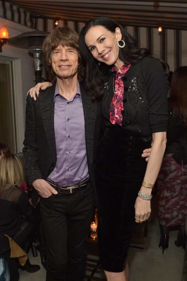 Singer Mick Jagger and fashion designer L'Wren Scott attend the launch celebration of the Banana Republic L'Wren Scott Collection hosted by Banana Republic, L'Wren Scott and Krista Smith at Chateau Marmont on November 19, 2013 in Los Angeles, California. (Photo by Charley Gallay/Getty Images for Banana Republic)