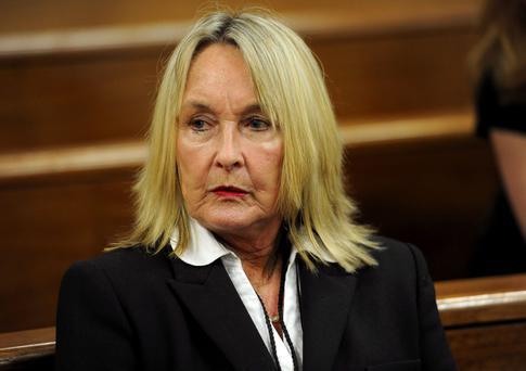 June Steenkamp, mother of the late Reeva Steenkamp, waits for proceedings to begin in court in Pretoria, South Africa, Tuesday, March 18, 2014