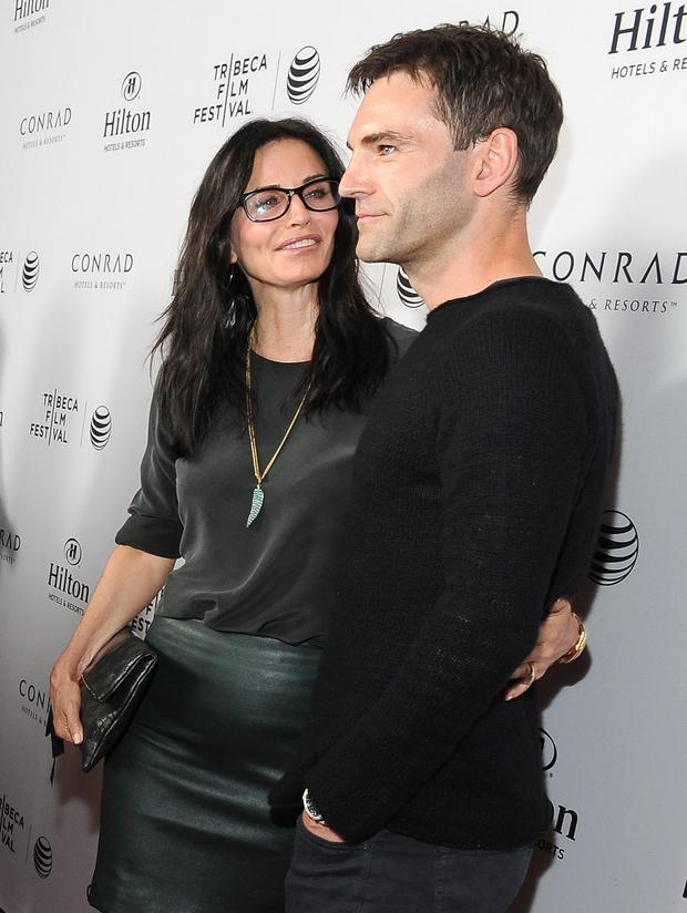 The pair laughed and chatted before they smiled for the photographers, Courteney's around the guitarist's waist. (Photo by Angela Weiss/Getty Images for Tribeca Film Festival)