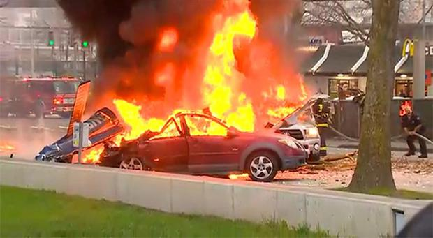 In this image made from video provided by KOMO-TV, smoke rises from the scene of a news helicopter crash outside the KOMO-TV studios near the space needle in Seattle.