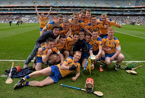 Portumna players celebrate with the Tommy Moore Cup